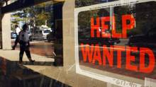 "A ""Help Wanted"" sign in the window advertises a job opening at a dry cleaners in Boston, Massachusetts in this file image from September 1, 2010. (BRIAN SNYDER/REUTERS)"
