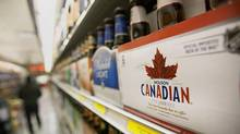 A six pack of Molson Coors Brewing Co. Canadian beer is displayed for sale (Scott Eells/Bloomberg)