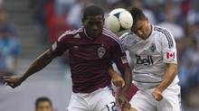 Vancouver Whitecaps FC Alain Rochat, right, fights for control of the ball with Colorado Rapids Hendry Thomas during first half of MLS soccer action in Vancouver on Sunday, September 23, 2012. (JONATHAN HAYWARD/THE CANADIAN PRESS)