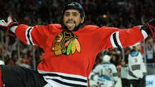 Chicago Blackhawks' Dustin Byfuglien acknowledges the fans after scoring the game winning goal against San Jose Sharks in the overtime of Game 3 of an NHL hockey Western Conference finals Friday, May 21, 2010, in Chicago. The Blackhawks won 3-2 in overtime. (AP Photo/Chicago Sun-Times, John J. Kim) (John J. Kim)