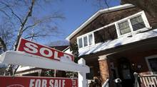 A 'sold' sign is seen in front of a home in Toronto's east end. (Deborah Baic/The Globe and Mail)