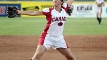 Canada's Jocelyn Cater pitches against Brazil in the first inning of a World Cup of Softball game in Oklahoma City, Sunday, July 1, 2012. (Brett Deering/AP)