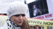 Yasmin Nakhuda stands with supporters outside an Animal Services offices in Toronto on Wednesday December 19, 2012 as she rallies support for the return of her monkey which was seized earlier this month after it was found wandering at an IKEA parking lot (Chris Young/The Canadian Press)