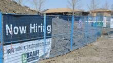 A construction company advertises for workers at a building site in Regina earlier this month. The Conference Board said Wednesday it will take another four years for Canada to get back to the pre-recession unemployment rate of 6 per cent. (ROY ANTAL FOR THE GLOBE AND MAIL)