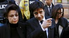 Jian Ghomeshi, a former celebrity radio host who has been charged with multiple counts of sexual assault, leaves the courthouse after the first day of his trial alongside his lawyer Marie Henein (L), in Toronto, February 1, 2016. (MARK BLINCH/REUTERS)