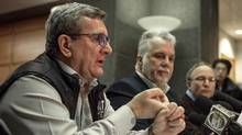 L-R: Régis Labeaume Quebec city mayor, Philippe Couillard, Quebec Premier, and Martin Coiteux, Minister of Public Security, hold a press conference following a shooting in a mosque at the Québec City Islamic cultural centre in Quebec city on January 30, 2017 (ALICE CHICHE/AFP/Getty Images)