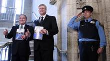 Canada's Finance Minister Jim Flaherty (left) and Prime Minister Stephen Harper walk to the House of Commons to deliver the budget on Parliament Hill in Ottawa March 21, 2013. (Blair Gable/Reuters)