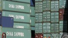 Containers are stacked on a ship at the Port of Halifax in this photo from 2007. 'It's interesting that the distance between the east coast of Canada and the west coast of India is closer than moving from the west coast of Canada to India,' Natural Resources Minister Joe Oliver said Tuesday. (Paul Darrow for The Globe and Mail)