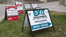 Real estate signs sit outside a condominium building on Lake Shore Blvd. West in Toronto. (Matthew Sherwood For The Globe and Mail)