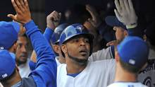 Jun 9, 2014; Toronto, Ontario, CAN; Toronto Blue Jays first baseman Edwin Encarnacion is greeted in the dugout by team mates after hitting a three-run home run in the first inning against Minnesota Twins at Rogers Centre. (Dan Hamilton/USA Today Sports)