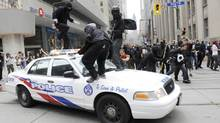 Anti-summit protesters clash with police in downtown Toronto, Ont June 26, 2010. Windows were smashed throughout the downtown core. (Kevin Van Paassen/The Globe and Mail)