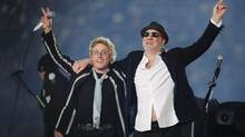 "In this Feb. 7, 2010 file photo, Roger Daltrey, left, and Pete Townshend acknowledge the crowd after performing during the second half of the NFL Super Bowl XLIV football game in Miami. Daltrey and Townshend are taking ""Quadrophenia"" and other Who classics on the road for a U.S. tour in fall 2012, but first plan what Daltrey calls a great finale for the Olympic Games in London. The Who tour kicks off in Sunrise, Fla., on November 1. (Mark J. Terrill/AP)"
