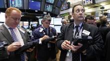 Traders work on the floor of the New York Stock Exchange (Brendan McDermid/REUTERS)