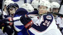 Columbus Blue Jackets' Samuel Pahlsson (26), of Sweden, checks St. Louis Blues' David Perron, left, into the boards during the first period of an NHL hockey game Monday, April 5, 2010, in St. Louis. (AP Photo/Jeff Roberson) (Jeff Roberson/Associated Press)