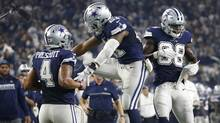 Dallas Cowboys' Dak Prescott (4), Ezekiel Elliott (21) and Dez Bryant (88) celebrate late in the second half of the Cowboys' 31-26 win over the Washington Redskins in an NFL football game Thursday, Nov. 24, 2016, in Arlington, Texas. (Ron Jenkins/AP)
