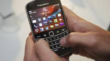 FILE PHOTO: A person uses the BlackBerry Bold 9900 at a release party to promote the BlackBerry 7 OS devices in Toronto August 3, 2011. (MARK BLINCH/REUTERS)