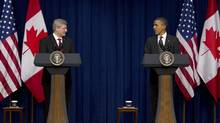 President Barack Obama and Canadian Prime Minister Stephen Harper speak in the South Court Auditorium on the White House complex in Washington, Wednesday, Dec. 7, 2011. (Carolyn Kaster/Carolyn Kaster/AP)