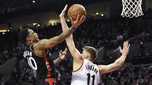 Toronto Raptors guard DeMar DeRozan drives to the basket on Portland Trail Blazers forward Meyers Leonard during a game on Feb. 4, 2016. The Raptors pulled the curtains back on their new $38-million practice facility on Wednesday. (Steve Dykes/AP)