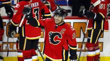 Calgary Flames' Jarome Iginla celebrates his 500th carrier goal during third NHL action against the Minnesota Wild in Calgary, Alta., Saturday, Jan. 7, 2012. (Jeff McIntosh/THE CANADIAN PRESS)