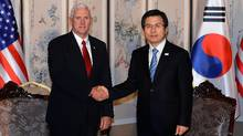 U.S. Vice President Mike Pence shakes hands with South Korean acting president and prime minister Hwang Kyo-ahn during their meeting on April 17, in Seoul, South Korea. (Pool/Getty Images)