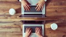 Young investors on their laptops. (Choreograph/iStockphoto)