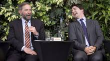 Liberal Leader Justin Trudeau laughs with NDP Leader Tom Mulcair as he speaks during a panel discussion on youth voting, Wednesday, March 26, 2014 in Ottawa. Mulcair is reiterating his openness to a possible coalition with the Liberals if it is necessary to topple Stephen Harper's Conservatives. THE CANADIAN PRESS/Adrian Wyld