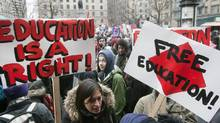 Students march through the downtown streets during a demonstration against higher tuition fees Thursday, February 23, 2012 in Montreal. (Ryan Remiorz/THE CANADIAN PRESS)