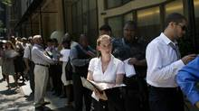 Job seekers waits in line to enter a career fair in New York. (Victor J. Blue/Bloomberg)