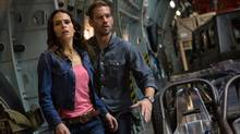 Jordana Brewster and Paul Walker in a scene from Fast & Furious 6. (Giles Keyte/Universal Pictures/AP)