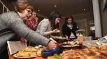 Kathy Frecker, James Topham, Claudine Mersereau and Nicole Riva start serving dinner at Andrea Chiu's cookbook club, exploring Momofuku recipes, in her Toronto home on March 6, 2016. (JENNIFER ROBERTS/JENNIFER ROBERTS FOR)