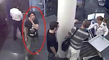 This surveillance image provided by Interpol shows who authorities believe is Luka Rocco Magnotta at a security checkpoint area. A state prosecutor says police are investigating two claimed French capital sightings of the Canadian porn actor wanted in connection with a gruesome murder in Montreal. (AP)