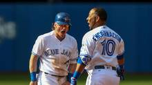 Toronto Blue Jays designated hitter Edwin Encarnacion (10) celebrates his winning single with third baseman Josh Donaldson (20) in the ninth inning against New York Yankees at Rogers Centre in Toronto on Sunday, Sept. 25, 2016. Blue Jays beat the Yankees 4-3. (Kevin Sousa/USA Today Sports)