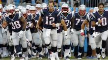 In this 2015 file photo, New England Patriots' Tom Brady (12) leads his team onto the field before a preseason NFL football game against the Carolina Panthers in Charlotte, N.C. (Bob Leverone/AP)