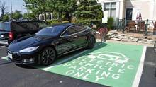 A Tesla Model S being charged at a Sun Country Highway station. (Michael Bettencourt for the Globe and Mail)