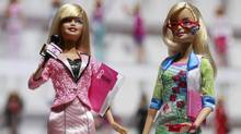 In this Feb. 14, 2010 file photo, news anchor Barbie, left, and computer engineer Barbie are arranged for a photo at the New York Toy Fair. A new study published Thursday, Jan. 26, 2017, in the journal Science suggests that girls as young as 6 can be led to believe that men are inherently smarter and more talented than women, making them less motivated to pursue novel activities and ambitious careers. (Mark Lennihan/AP)