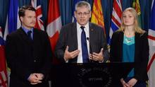 NDP members of the Ethics Committee Charlie Angus, middle, Mathieu Ravignat, right, and Charmaine Borg outline NDP priorities for the Ethics Committee during a press conference on Parliament Hill in Ottawa on Nov. 19, 2013. (SEAN KILPATRICK/THE CANADIAN PRESS)