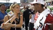 This 2009 photo shows TV Azteca reporter Ines Sainz, left, after measuring the bicep of Arizona Cardinals wide receiver Steve Breaston, right, during the team's media day for Super Bowl XLIII, in Tampa, Fla. Ms. Sainz was harassed later that year in the New York Jets locker room, though not all female reporters quickly came to her defence. (Ross D. Franklin/AP)