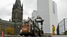 A construction worker watches as a hole is drilled near the north tower of Parliament Hill's West Block on Oct. 15, 2010. (Adrian Wyld/THE CANADIAN PRESS)