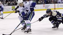 Vancouver's Brandon Sutter, left, seen in a game against Columbus in November, 2015, says he's confident about the progress younger Canucks players have made in the offseason. (Jay LaPrete/The Associated Press)