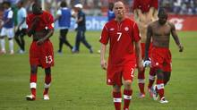 Followed by teammates, Canada's Hume Iain, front, at the end of a 2014 World Cup qualifying soccer match against Honduras in San Pedro Sula, Honduras, Tuesday, Oct 16, 2012. (Associated Press)