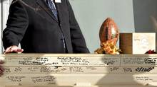 A football sits on the signed casket of Walter Borden-Wilkins during his funeral in Grand Prairie, Alberta on Thursday Oct. 27, 2011. Borden-Wilkins, 15, was killed in a car accident along with Matt Deller, 16, Tanner Hildebrand, 15 and Vincent Stover, 16, in Grand Prairie on Saturday. (JASON FRANSON/THE CANADIAN PRESS/JASON FRANSON/THE CANADIAN PRESS)