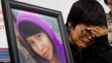 Matilda Fowler weeps during a news conference in Vancouver on Dec. 12, 2012, next to a photo of her daughter, Summer 'CJ' Morningstar Fowler, of the Gitanmaax First Nation near Hazelton, B.C. (DARRYL DYCK/THE CANADIAN PRESS)