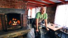Chef Todd Perrin stands in his restaurant in the historic Mallard Cottage in Quidi Vidi Village, St. John's NL. Mallard Cottage, a National Historic site, is thought to be one of the oldest structures in Canada. The restaurant focus is traditional Newfoundland foods, served in a new way. The chairs have been re-finished with seal leather. (Paul Daly)