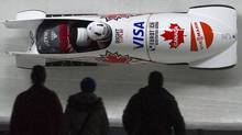 Canada's Helen Upperton and Shelly-Ann Brown (L) head to a third place finish during the women's World Cup Bobsleigh in Whistler, British Columbia February 2, 2012. REUTERS/Andy Clark (Andy Clark/Reuters)