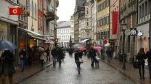 People walk on a shopping street in the southern German town of Konstanz January 17, 2015. (Arnd Wiegmann/REUTERS)