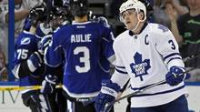 Toronto Maple Leafs' Dion Phaneuf reacts as members of the Tampa Bay Lightning celebrate a goal during the third period of their NHL hockey game in Tampa, Florida April 24, 2013. (MIKE CARLSON/REUTERS)