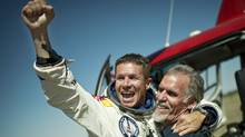 Pilot Felix Baumgartner of Austria and Technical Project Director Art Thompson of the U.S. celebrate after Baumgartner successfully completed the final manned flight for Red Bull Stratos in Roswell, New Mexico in this October 14, 2012 handout photo. Baumgartner was attempting to break a 52-year-old record by skydiving from 23 miles (37 km). He also attempted to break the sound barrier while in freefall. (Joerg Mitter/Reuters)
