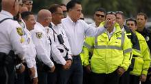 Republican presidential candidate and former Massachusetts governor Mitt Romney greets police officers who accompanied his motorcade to the airport in West Palm Beach, Fla Sept. 21, 2012. (Brian Synder/Reuters)