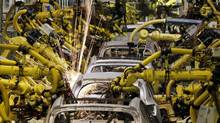 Robotic machines weld bodies of Kia cars in its factory in Zilina, 200 kilometres north of Bratislava October 3, 2012. (PETR JOSEK/REUTERS)