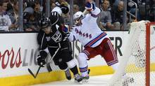 Los Angeles Kings center Anze Kopitar battles for the puck behind the net with New York Rangers defenceman Dan Girardi in the third period during game one of the 2014 Stanley Cup Final at Staples Center in Los Angeles on June 4. (Kirby Lee/USA Today Sports)